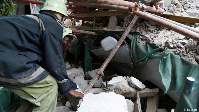 Rescuers search for survivors amongst the rubble of a collapsed building in the Kariakoo district of central Dar es Salaam March 29, 2013. The number of those killed in Tanzania's commercial capital on Friday when a building under construction collapsed remains unknown. REUTERS/Emmanuel Herman (TANZANIA - Tags: SOCIETY DISASTER)