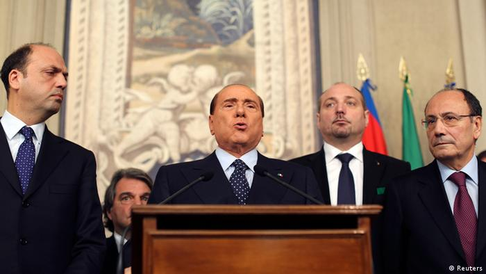 Italy's former Prime Minister Silvio Berlusconi (C) speaks after meeting with Italian President Giorgio Napolitano at Quirinale palace in Rome March 21, 2013. REUTERS/Alessandro Bianchi (ITALY - Tags: POLITICS)