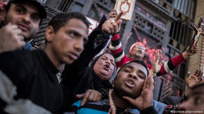 Egyptian protesters shout slogans during a protest against Egyptian President Mohamed Morsi and the Muslim Brotherhood in front of the Prosecutor-General's office in Cairo, Egypt, 29 March 2013. EPA/OLIVER WEIKEN pixel