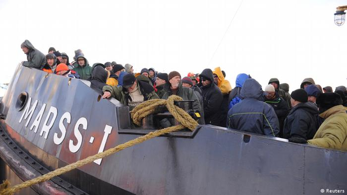People rescued on an emergency boat Photo: REUTERS/LETA/Edijs Palens
