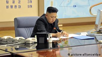 epa03644057 A picture released by the North Korean Central News Agency (KCNA) on 29 March 2013 shows North Korean leader Kim Jong-un convening an urgent operation meeting at 0:30 am on 29 March 2013 at an undisclosed location, in which he ordered strategic rocket forces to be on standby to strike US and South Korean targets at any time. Kim's order followed two US stealth bombers' first-ever drill over the Korean Peninsula the previous day. The North berated the drill as US hostility against it. EPA/KCNA SOUTH KOREA OUT NO SALES