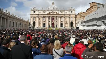 A general view of crowds as Pope Francis appears prior to delivering his first 'Urbi et Orbi' blessing from the balcony of St. Peter's Basilica during Easter Mass on March 31, 2013 in Vatican City, Vatican. Pope Francis delivered his message to the gathered faithful from the central balcony of St. Peter's Basilica in St. Peter's Square after his first Holy week as Pontiff. (Photo by Dan Kitwood/Getty Images)