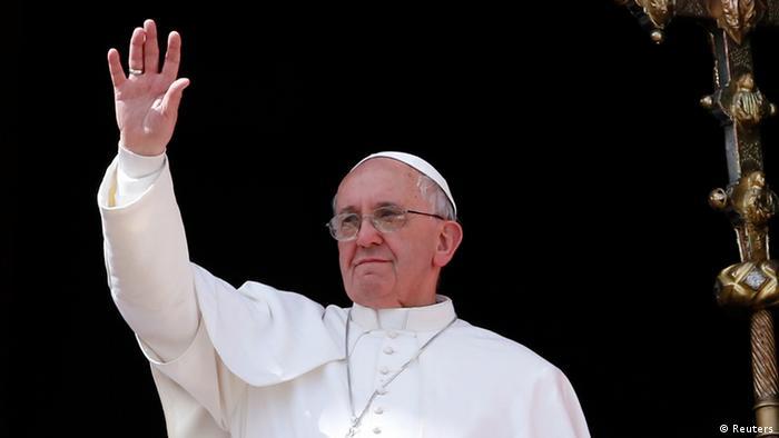 Pope Francis waves during his Urbi et Orbi address REUTERS/Stefano Rellandini