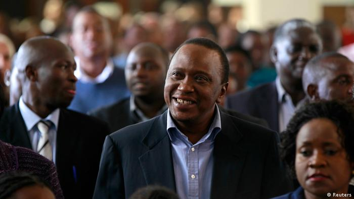 Kenya's newly elected President Uhuru Kenyatta attends the Easter Mass at the Saint Austin's Catholic church in the capital Nairobi, March 31, 2013. Kenya's Supreme Court upheld Uhuru Kenyatta's presidential election victory on Saturday and his defeated rival accepted the ruling, helping douse tensions after tribal violence blighted the election five years ago. REUTERS/Thomas Mukoya (KENYA - Tags: POLITICS ELECTIONS)