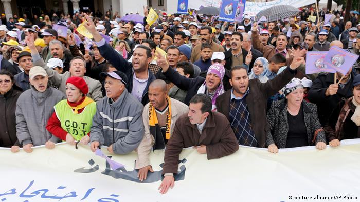 Moroccan union members chant for the fall of the government while holding a banner reading in Arabic Solidarity: national march of protest. as thousands of labor union activists marched through Morocco's capital Rabat Sunday March 31, 2013. (AP Photo/Abdeljalil Bounhar)