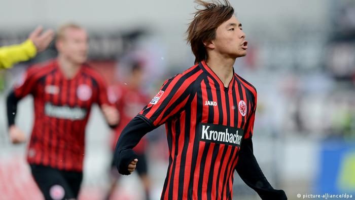 Takashi Inui celebrates a goal for Eintracht Frankfurt against Greuther Fürth, 31.03.2013. (Photo via David Ebener/dpa)