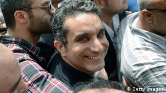 Egyptian satirist and television host Bassem Youssef surrounded by supporters upon arrival to prosecutor's office