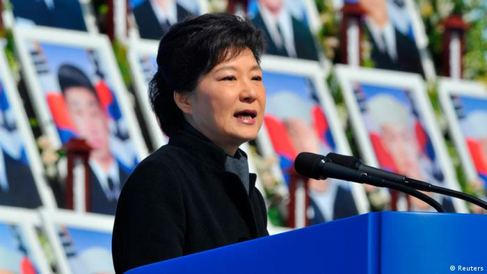 REFILE - ADDING POOL TO BYLINE South Korea's President Park Geun-Hye speaks in front of photographs of sailors who died, during an event marking the third anniversary of the sinking of a South Korean naval vessel by what Seoul insists was a North Korean submarine, at the national cemetery in Daejeon March 26, 2013. 46 sailors died when the Cheonan corvette sunk. REUTERS/Kim Jae-Hwan/Pool (SOUTH KOREA - Tags: POLITICS ANNIVERSARY MARITIME MILITARY)