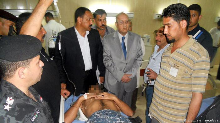 [38521907] Tanker bomb targeting a police station in Tikrit epa03646816 An Iraqi policeman receives medical treatment at a local hospital in Tikrit city, northern Iraq, on 01 April 2013. At least eight people were killed among them policemen and 14 others wounded in a tanker bomb targeting a police station in Tikrit city northern Iraq, police said. EPA/STR +++(c) dpa - Bildfunk+++
