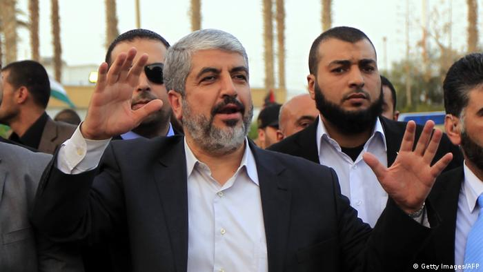 Hamas leader in exile Khaled Meshaal waves goodbye upon his departure from the Gaza Strip on December 10, 2012 in Rafah, on the border with Egypt. Exiled Hamas chief Khaled Meshaal left Gaza after a historic first visit to the tiny Palestinian enclave. AFP PHOTO/ SAID KHATIB (Photo credit should read SAID KHATIB/AFP/Getty Images)