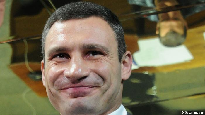 Ukrainian heavyweight boxing superstar Vitali Klitschko gives a thumbs up as he and his wife Natalya (R) leave a polling station after casting their ballots, in Kiev on October 28, 2012, during national parliamentary elections. Ukraine voted today in legislative polls seen as a test of democracy under President Viktor Yanukovych with jailed opposition leader Yulia Tymoshenko forced to watch from the sidelines. AFP PHOTO / ALEXANDER NEMENOV (Photo credit should read ALEXANDER NEMENOV/AFP/Getty Images)