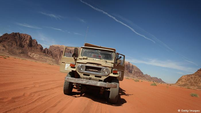 Jeeps tour the desert around Wadi Rum