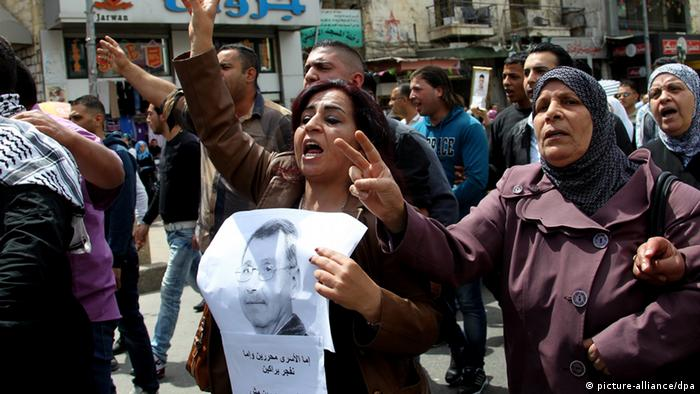 Palestinians protest in the West Bank after news of the death of Maysara Abu Hamdiyeh
