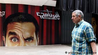 A poster in Cairo featuring Egyptian comedian Bassem Youssef