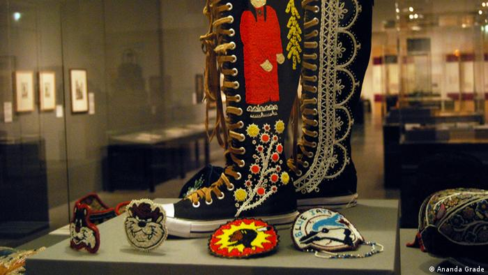 A pair of sneakers decorated with colorful Iroquois beadwork.