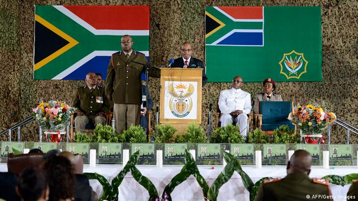 South African President Jacob Zuma (C) gives a speech during a memorial service for the South African soldiers who died during a battle with rebels in the Central African Republic at Swartzkop Air Force Base in Pretoria on April 2, 2013.The thirteen soldiers were killed on March 23, 2013 on the outskirts of Bangui, twenty seven others were wounded. Zuma who is facing anger at home dismissed claims that South African troops deployed in restive Central Africa were protecting private business interests as 'conspiracy theories.' AFP PHOTO / STEPHANE DE SAKUTIN (Photo credit should read STEPHANE DE SAKUTIN/AFP/Getty Images)