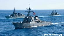 [21983485] Last day of Exercise Keen Sword 2011 epa02493460 A US Navy handout image made available 13 December 2010 showing the USS John S. McCain (DDG-56), an Arleigh Burke-class destroyer, joining a combined formation of twenty-six Japan Maritime Self-Defense Force and U.S. ships with 7th Fleet underway in the Pacific Ocean, 10 December 2010, for a photo exercise during the last day of Exercise Keen Sword 2011. Keen Sword is a bilateral exercise designed to strengthen military operations between the U.S. and Japan, which remains a key strategic partner in the Northeast Asia Pacific region. EPA/MCSN Cheng S. Yang/HANDOUT EDITORIAL USE ONLY