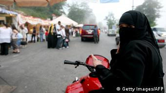 A veiled Saudi women rides a motorbike in the tourist town of Aley, east of Beirut on July 23, 2008. The Lebanese tourism ministry predicts between 1.3 and 1.6 million tourists to travel to Lebanon this year after a breakthrough deal among rival political clans that has brought back a semblance of normalcy to a country that just months ago stood on the brink of civil war. AFP PHOTO/JOSEPH BARRAK (Photo credit should read JOSEPH BARRAK/AFP/Getty Images)