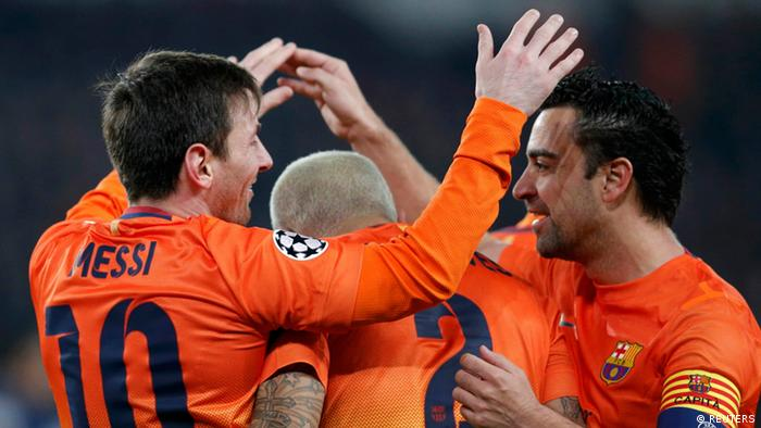 Barcelona's Lionnel Messi (L) celebrates with Daniel Alves and Xavi Hernandez (R) after scoring goal against Paris St Germain during their Champions League quarter-final first leg soccer match at the Parc des Princes Stadium in Paris, April 2, 2013. REUTERS/Christian Hartmann (FRANCE - Tags: SPORT SOCCER TPX IMAGES OF THE DAY)