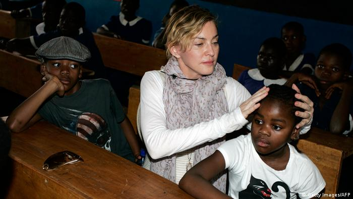 Madonna touches young Malawi boy's head