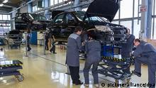 ITAR-TASS: TOLYATTI, RUSSIA. FEBRUARY 27, 2013. Workers on the assembly line of the 'road version' of Lada Granta Sport car at OAO (JSC) AvtoVAZ plant in Togliatti in Samara Oblast (Region). (Photo ITAR-TASS/ Andrey Kholmov)