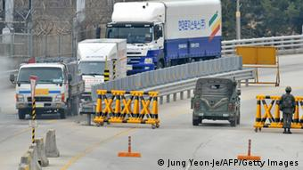 South Korean trucks arrive from North Korea's Kaesong Industrial Complex at a military check point of the inter-Korean transit office in Paju near the Demilitarized Zone (DMZ) dividing the two Koreas on April 1, 2013. South Korean workers and cargo on April 1, headed for the Kaesong Industrial Complex without a hitch despite North Korea's recent threat to close the joint industrial zone in the communist country. AFP PHOTO / JUNG YEON-JE (Photo credit should read JUNG YEON-JE/AFP/Getty Images)