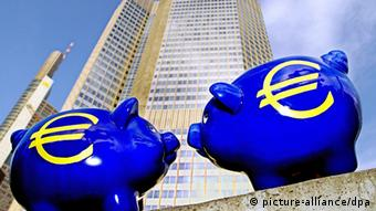 ECB building in Frankfurt with piggy banks
