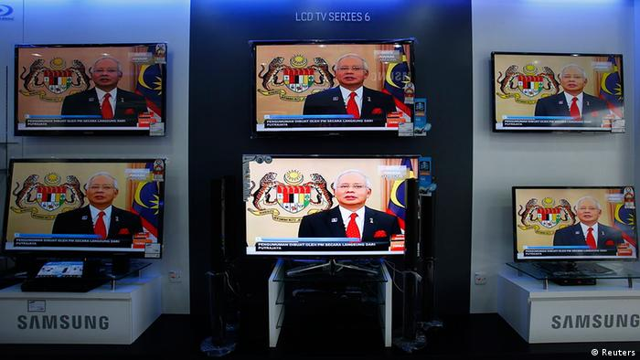 Televisions in a shop window showing Images of Malaysia Prime Minister Najib Razak /Archive Image from 2013)