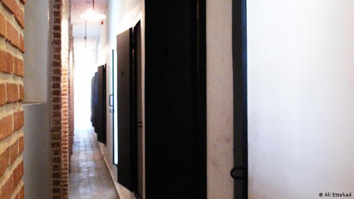 Hallway with cell doors at Qasr Prison in Tehran, a political prison that has been transformed into a museum