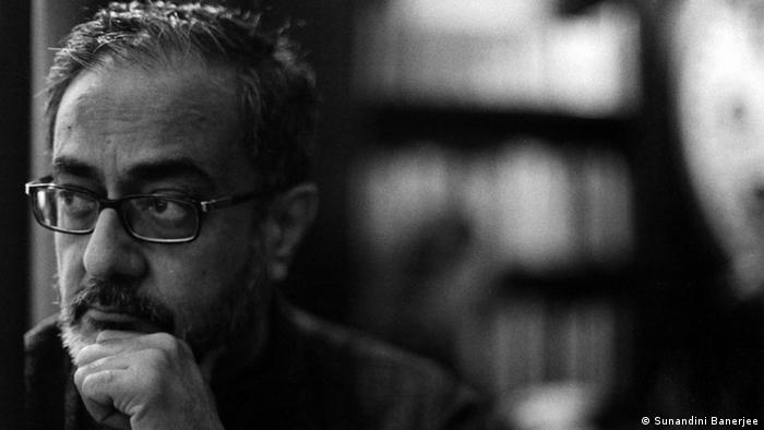 A black-and-white portrait of Indian publisher Naveen Kishore