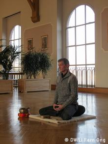 Catholic deacon Bruno Liesenfeld leads meditation sessions for both inmates and staff in the church hall at Siegburg prison
