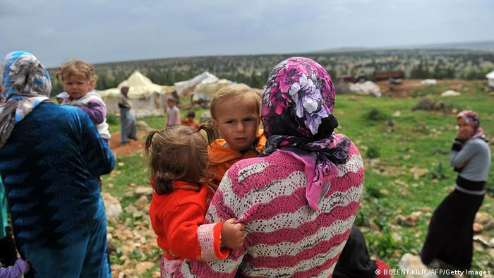 Syrian refugees on the Turkish border Photo: BULENT KILIC/AFP/Getty Images
