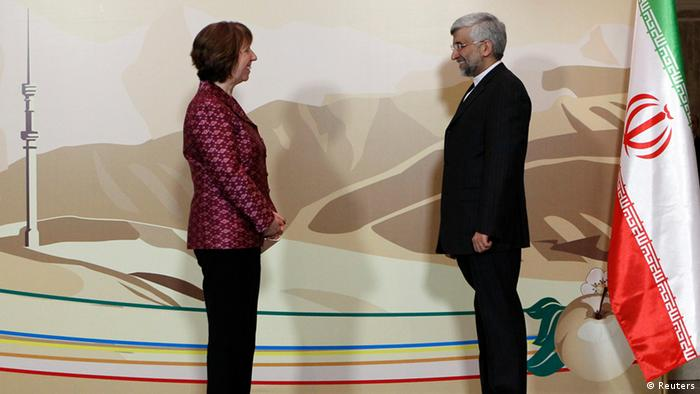 Iran's Chief negotiator Saeed Jalili (R) and European Union Foreign Policy chief Catherine Ashton stand for a photograph before talks (Photo: REUTERS/Shamil Zhumatov)