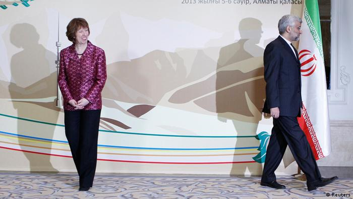 Iran's Chief Negotiator Saeed Jalili (R) and European Union Foreign Policy Chief Catherine Ashton walk away after posing for a photograph before talks in Almaty April 5, 2013. Iran appeared to side-step responding to proposals by world powers to defuse tensions over its nuclear programme at talks in Kazakhstan on Friday, diplomats said, and instead came up with its own plan - a measure of the gulf between the two sides. REUTERS/Shamil Zhumatov (KAZAKHSTAN - Tags: POLITICS TPX IMAGES OF THE DAY ENERGY)
