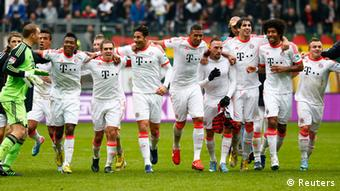 Bayern Munich's players celebrate after winning their German first division Bundesliga soccer match against Eintracht Frankfurt and the German soccer Championships in Frankfurt, April 6, 2013. Bayern Munich won their 22nd Bundesliga title in record time on Saturday after beating Eintracht Frankfurt 1-0 to open up an unassailable 20-point lead with six games left in the season. REUTERS/Kai Pfaffenbach (GERMANY - Tags: SPORT SOCCER) DFL RULES TO LIMIT THE ONLINE USAGE DURING MATCH TIME TO 15 PICTURES PER GAME. IMAGE SEQUENCES TO SIMULATE VIDEO IS NOT ALLOWED AT ANY TIME. FOR FURTHER QUERIES PLEASE CONTACT DFL DIRECTLY AT + 49 69 650050