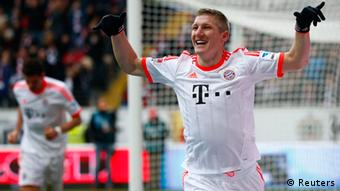 Bayern Munich's Bastian Schweinsteiger celebrates after scoring a goal with a back heel kick during their German first division Bundesliga soccer match against Eintracht Frankfurt in Frankfurt, April 6, 2013. REUTERS/Kai Pfaffenbach (GERMANY - Tags: SPORT SOCCER) DFL RULES TO LIMIT THE ONLINE USAGE DURING MATCH TIME TO 15 PICTURES PER GAME. IMAGE SEQUENCES TO SIMULATE VIDEO IS NOT ALLOWED AT ANY TIME. FOR FURTHER QUERIES PLEASE CONTACT DFL DIRECTLY AT + 49 69 650050