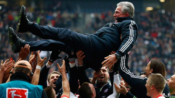 Bayern Munich's players throw coach Jupp Heynckes in the air after winning their German first division Bundesliga soccer match against Eintracht Frankfurt and the German soccer Championships in Frankfurt, April 6, 2013. Bayern Munich won their 22nd Bundesliga title in record time on Saturday after beating Eintracht Frankfurt 1-0 to open up an unassailable 20-point lead with six games left in the season. REUTERS/Kai Pfaffenbach (GERMANY - Tags: SPORT SOCCER) DFL RULES TO LIMIT THE ONLINE USAGE DURING MATCH TIME TO 15 PICTURES PER GAME. IMAGE SEQUENCES TO SIMULATE VIDEO IS NOT ALLOWED AT ANY TIME. FOR FURTHER QUERIES PLEASE CONTACT DFL DIRECTLY AT + 49 69 650050