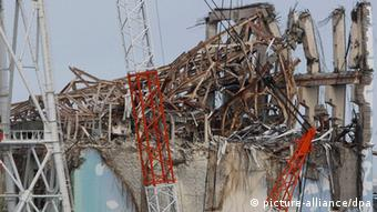 In this Feb. 20, 2012 file photo, damaged Unit 3 reactor building of Tokyo Electric Power Co.'s tsunami-crippled Fukushima Dai-ichi nuclear power plant is seen in Fukushima prefecture, northeastern Japan. (AP Photo/Issei Kato, File)