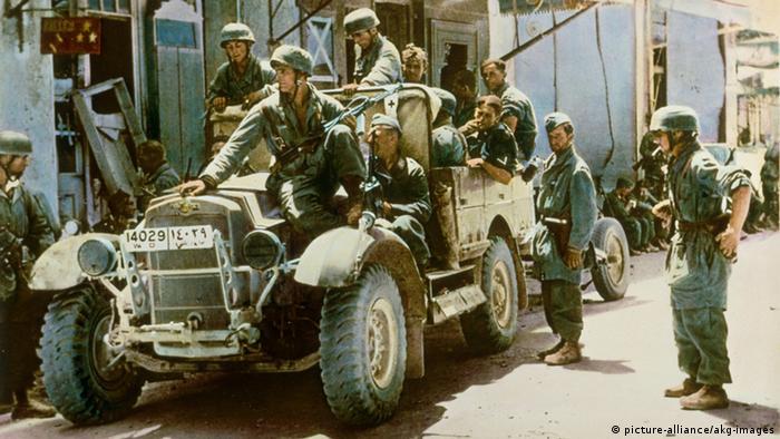 Soldados em carro de combate