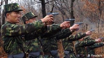 North Korean soldiers take part in a shooting drill in an unknown location in this picture taken on April 6, 2013 and released by North Korea's official KCNA news agency in Pyongyang on April 7, 2013. REUTERS/KCNA