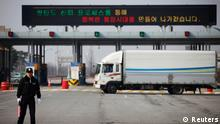 A South Korean security guard keeps watch as trucks make a U-turn after they were stopped from entering the Kaesong industrial complex in North Korea at the South's Customs, Immigration and Quarantine (CIQ) area, just south of the demilitarised zone separating the two Koreas, in Paju, north of Seoul, April 4, 2013. North Korea barred entry to a joint industrial complex it shares with the South for a second day on Thursday, the South Korean Unification Ministry said, but would allow 222 South Korean workers to leave the zone through the day. REUTERS/Kim Hong-Ji (SOUTH KOREA - Tags: BUSINESS INDUSTRIAL POLITICS)