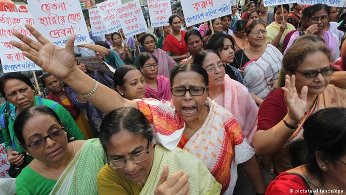 Bangladeshi women shout slogans during the rally as several Bangladeshi women's groups came out in protest against Hifazat-e Islam in the capital of Dhaka