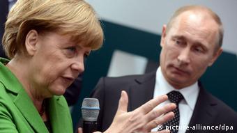 Bundeskanzlerin Angela Merkel und Russlands Staatspräsident Wladimir Putin (Foto: Jochen Lübke/dpa)