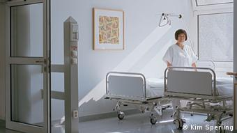 A nurse moving patients' bed at a German hospital