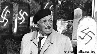 Simon Wiesenthal in 1992 in a Jewish cemetery defaced with swastikas