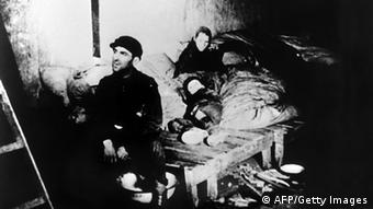 A family in a house in the Warsaw Jewish ghetto AFP/Getty Images)