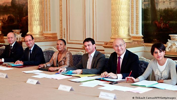 French President Francois Hollande (2ndL), Foreign Minister Laurent Fabius (L), Justice Minister Christiane Taubira (3rdL), Interior Minister Manuel Valls (C), Labour Minister Michel Sapin (2ndR), and Minister for Women's Rights and Government Spokeperson, Najat Vallaud-Belkacem (R) attend the weekly cabinet meeting at the Elysee Palace in Paris on June 27, 2012 in Paris. AFP PHOTO / POOL / THIBAULT CAMUS (Photo credit should read THIBAULT CAMUS/AFP/GettyImages)