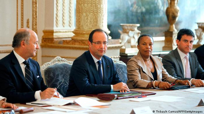 French President Francois Hollande (2ndL), Foreign Minister Laurent Fabius (L), Justice Minister Christiane Taubira (3rdL) and Interior Minister Manuel Valls (R) attend the weekly cabinet meeting at the Elysee Palace in Paris on June 27, 2012 in Paris. AFP PHOTO / POOL / THIBAULT CAMUS (Photo credit should read THIBAULT CAMUS/AFP/GettyImages)