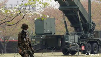 AJapan Self-Defence Forces soldier stands guard near Patriot Advanced Capability-3 (PAC-3) missiles at the Defence Ministry in Tokyo April 9, 2013. REUTERS/Issei Kato