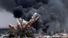 Symbolbild Explosion Feuer Rauch Bombenangriff